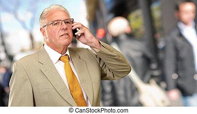 Senior Man Talking On Phone, Outdoor