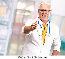Happy Male Doctor With Thumbs Up, Indoor