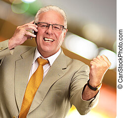 Senior Business Man Using Phone Cheering, Outdoor