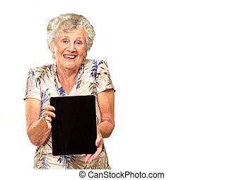 Portrait Of A Senior Woman Holding A Digital Tablet On White...