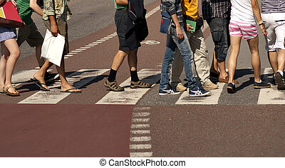 Crossing street - Legs of people crossing a street with...