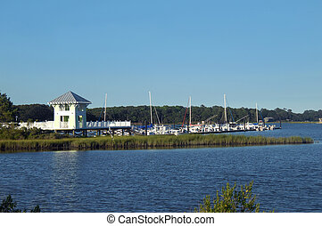 Cape Charles Marina has boats and yachts docked at pier....