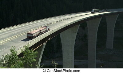 Trucks on high bridge 05 - Semi trailer truck traffic...