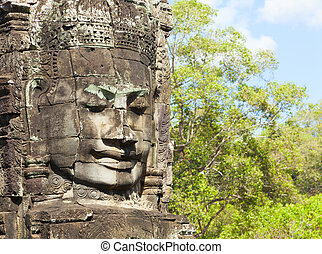 Faces of Bayon temple - Massive stone faces decorating...
