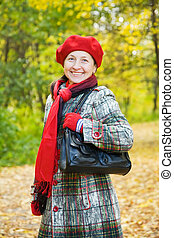 Happy mature woman in autumn - Happy mature woman in coat...