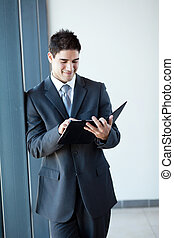young businessman using tablet computer in office