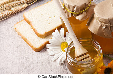 honey, flowers, spike and bread