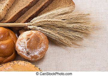 bread, bun, spike and other bakery products on sacki