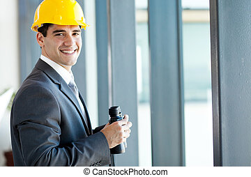 happy young male architect with binoculars