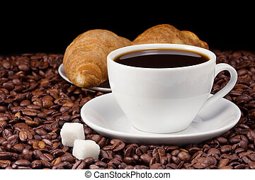 coffee and croissant on beans - cup of coffee and croissant...