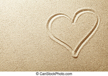 Sand Heart - Heart drawn in the sand. Beach background. Top...