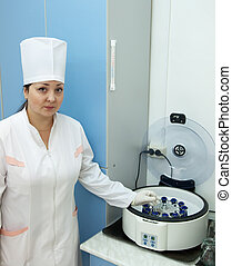 Doctor working with  blood centrifuge
