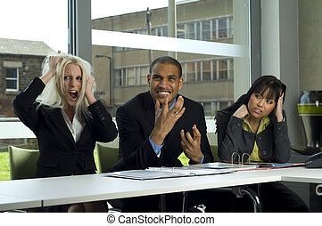 Stressed work colleagues at a meeting