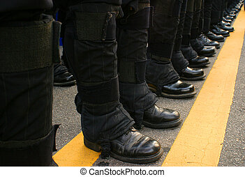 Feet on Line - Police stand on a line during a protest.