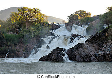 Epupa waterfalls on the border of Angola and Namibia - A...