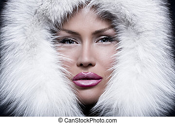 Portrait beautiful girl wearing white fur