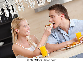 Married couple eats in the kitchen