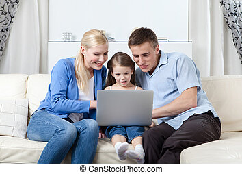 Happy family surf on the internet - Nuclear family has a day...