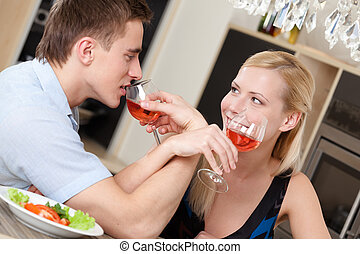 Married couple has dating supper in the kitchen