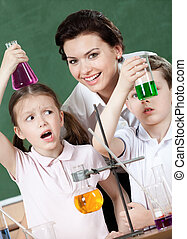 Little pupils wonder at the result of the chemical experiment