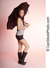 woman with umbrella - pretty woman with long brown hair and...