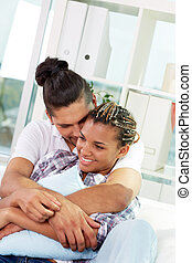 Happy together - Image of young guy embracing his girlfriend...