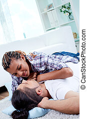 Couple at home - Image of young guy and his girlfriend...