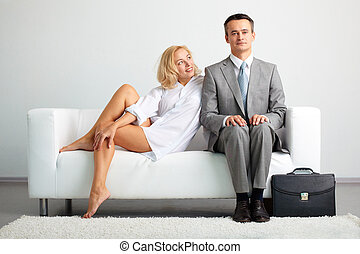 Flirt - Lovely woman looking at serious businessman while...