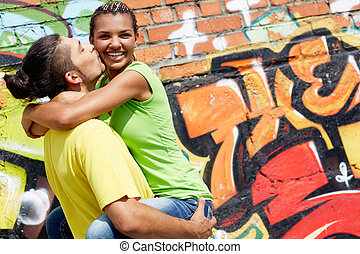 Happiness - Image of young man holding his happy girlfriend...