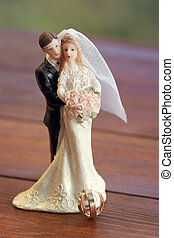 Bride and groom figurines on the boards