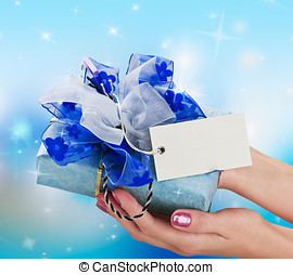 Blue gift in a female hand