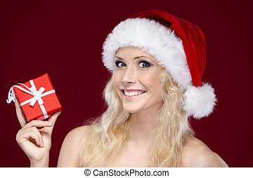 Woman in Christmas cap hands present wrapped with red paper, isolated on purple