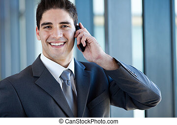 business man talking on cell phone - happy successful young...