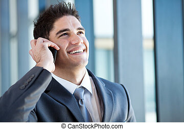 young businessman talking on mobile phone - happy young...
