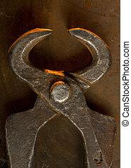 Old metal tongs