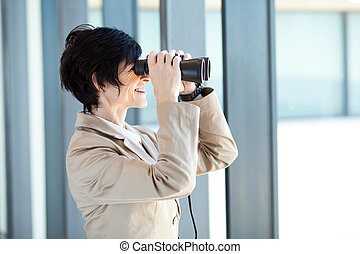 businesswoman using binoculars