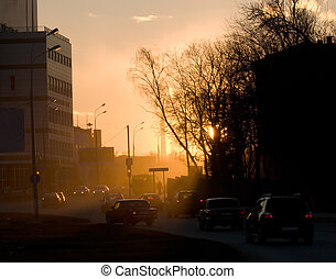Evening urban landscape. The road sunset, cars.