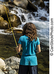 Fishing the Rapids - Young girl fishing in rapids of stream...
