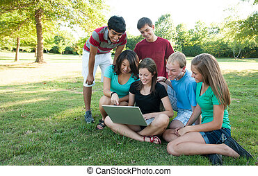 Muti-ethnic group of teens outside - Multi-ethnic group of...