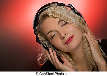 Blond woman listening to the music