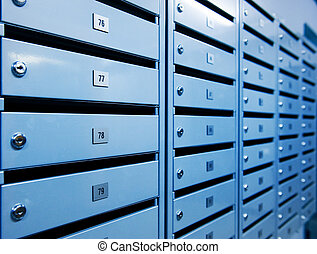 Metal postboxes toned in blue