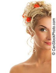 Beautiful young woman with fresh spring flowers in her hair....