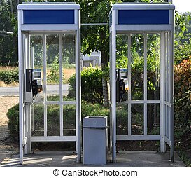 Telephone Booths - Telephone booths, outdoors.