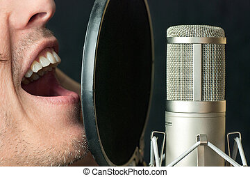 Man Sings Into Condenser Microphone, Close - Super close-up...