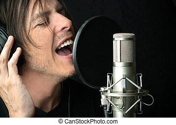 Man Sings Into Condenser Microphone - Close-up of a man...