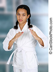 Karate - Teen girl doing karate at a studio