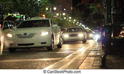 calgary night patrol - A busy nightlife city street in...