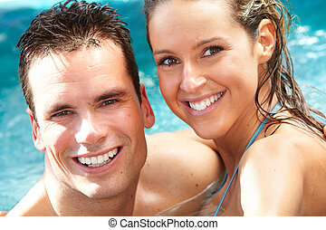 Young couple in jacuzzi. - Young happy couple in jacuzzi....