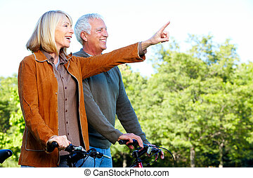 Happy senior couple cyclist. Healthy lifestile.