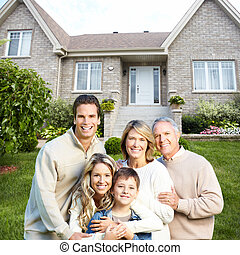 Happy family near new house Real estate concept